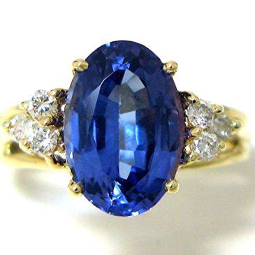 Gorgeous 18k Yellow Gold 3.09 Ct Oval Tanzanite and Diamond ring
