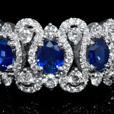 A Magnificent Diamond and Blue Oval Sapphire 18k White Gold Ring