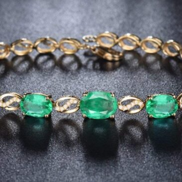 A Gorgeous 14K White Yellow Gold Emerald Diamond Link Bracelet