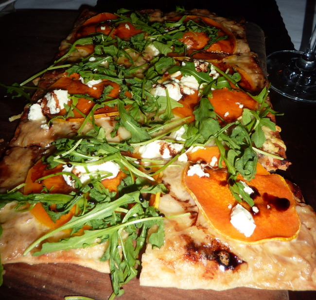 Tarte aux Courge: butternut squash, Emmentaler, fried sage, pumpkin seeds, pomegranate, arugula