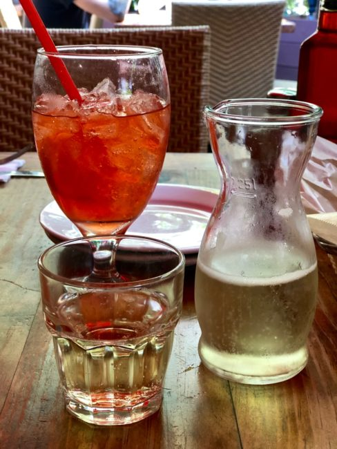 Venetian-style Spritzer Della Casa: prosecco with special house-blended bitters and fresh orange ($12