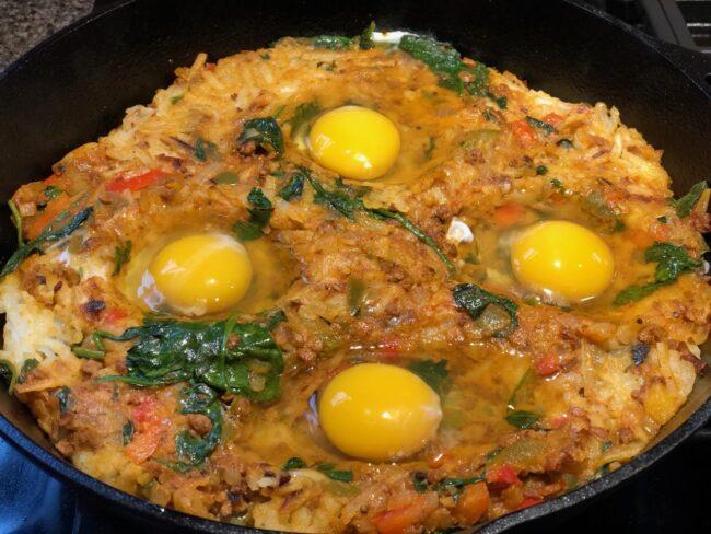 eggs on top of potato mixture