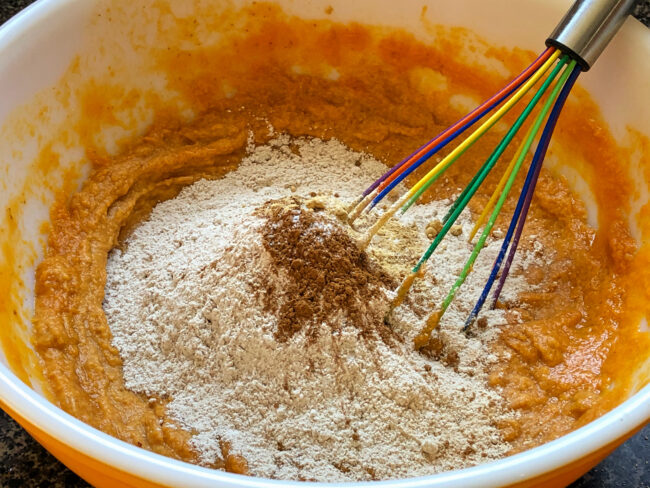 whisking flour, cinnamon, ginger, and salt together