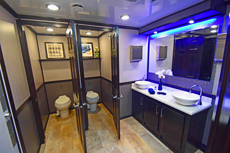 portable restroom trailer models blue lights
