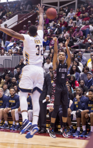 Patrick Cole shoots over NC A&T Defender. Photo by Anthony Ortiz / Echo staff photographer