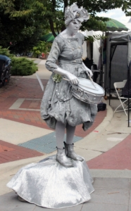 The Silver Drummer Girl played for tips as crowds walked by at the CenterFest Arts Festival on Saturday Sept. 24.