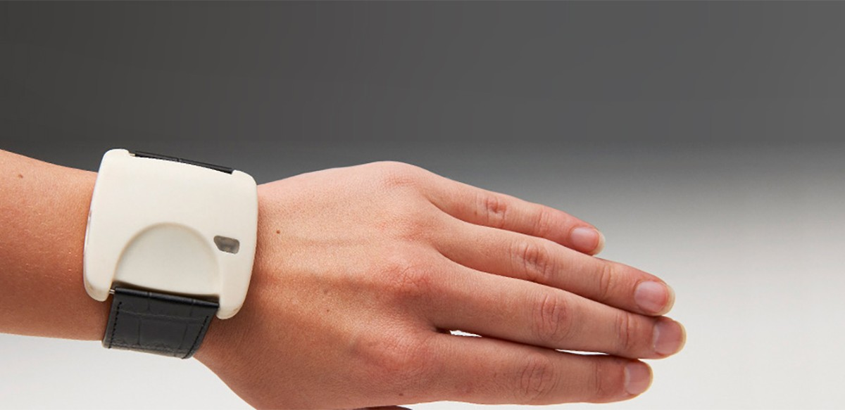 [Image of hand and forearm with a wrist monitoring device.]