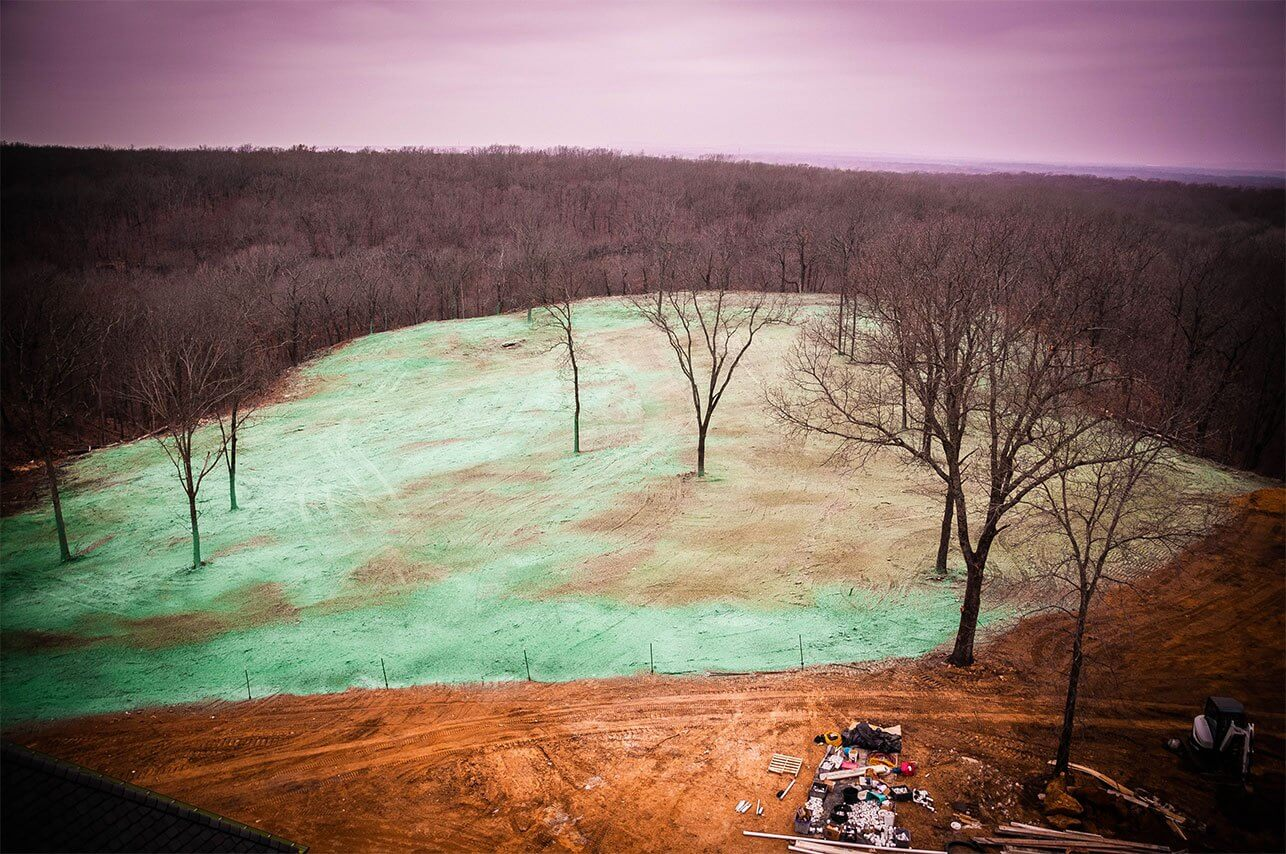 Oklahoma Residential Jobsite-March-2019-Aerial shot of Semper Fi Hydroseed showing several acres of woodeded area with hydroseed applied