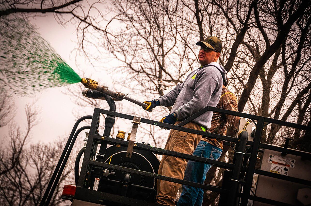Oklahoma Residential Jobsite-March-2019-Clint Bates of Semper Fi Hydroseed spraying from trailer