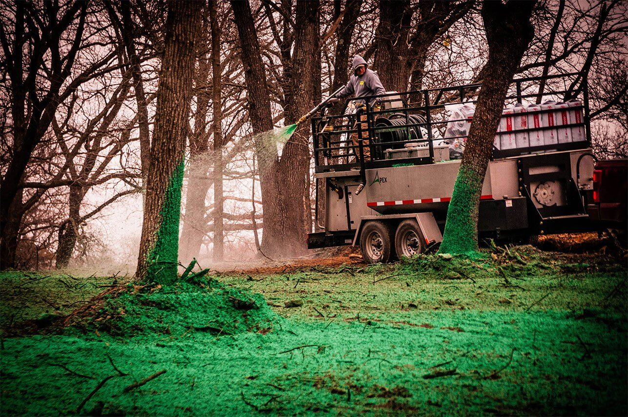 Oklahoma Residential Jobsite-March-2019-Semper Fi Hydroseed spraying in wooded area from trailer