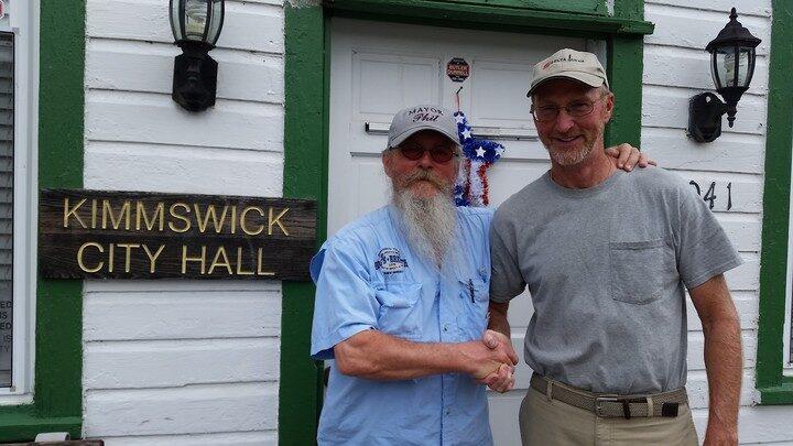 Senior Captain Michael Williams and Mayor Philip D. Stang