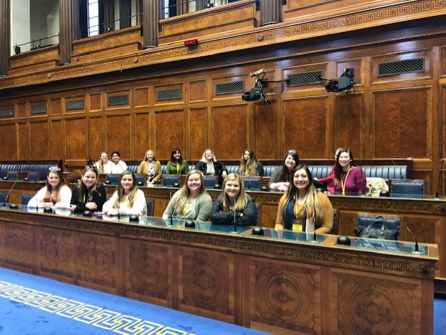 photo of students sitting in parliament chambers