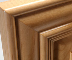Mitered cabinet door in select alder - close up view of mitered joint