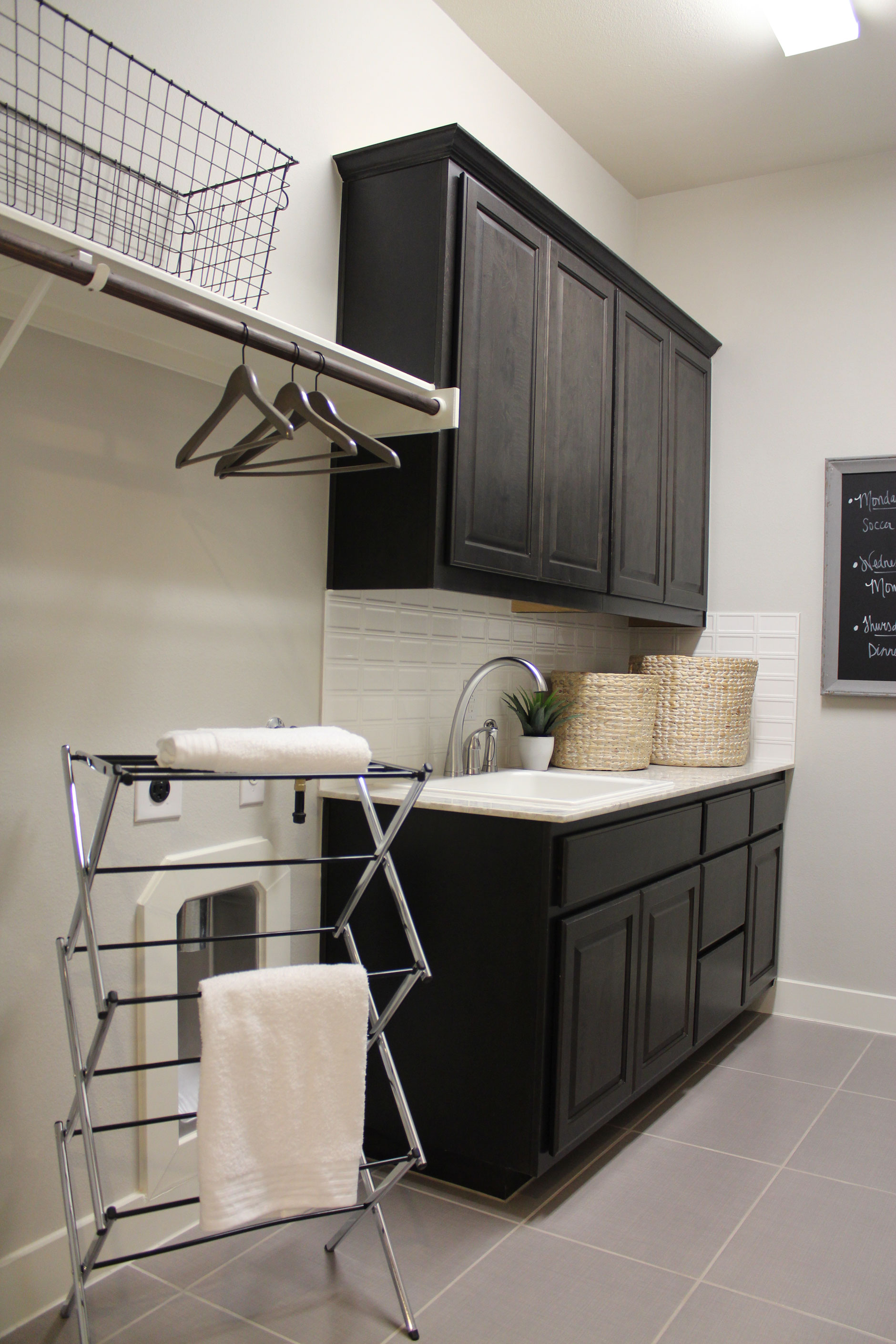 Black painted laundry room cabinets with raised panel cope and stick cabinet doors with OE3, IE1, RP1 profiles