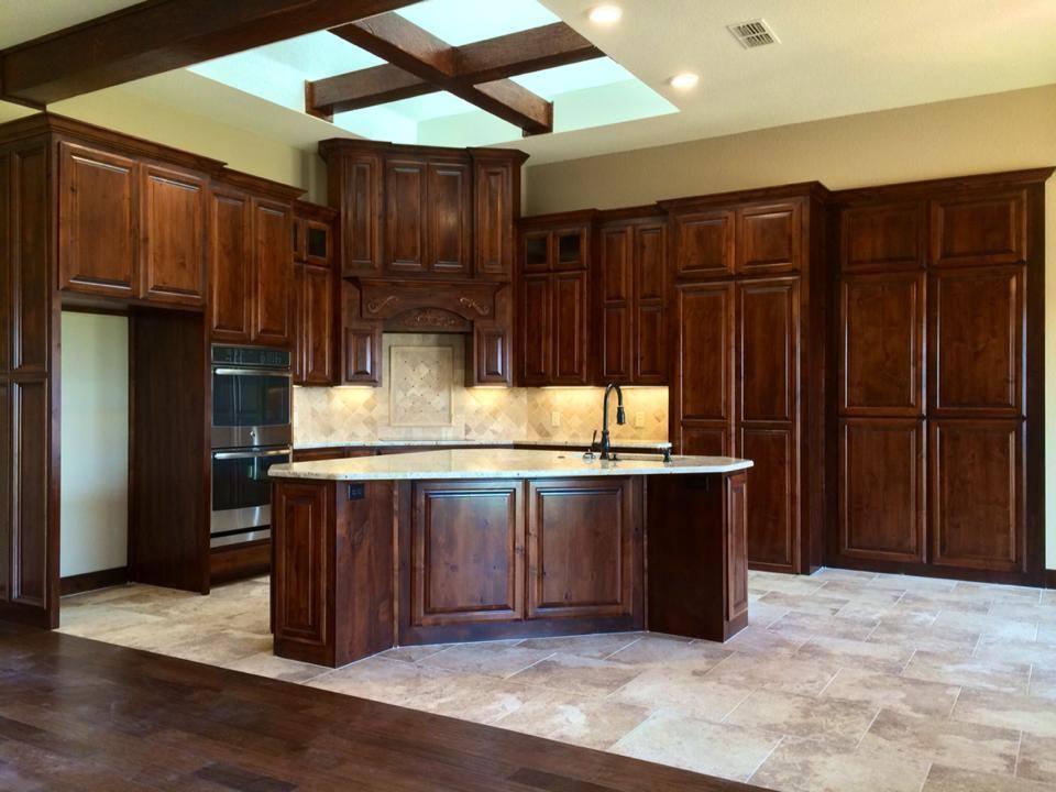 Alder kitchen cabinets stained