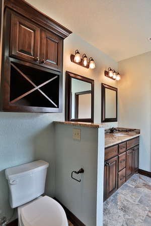 bathroom cabinets in alder with x shaped towel holder