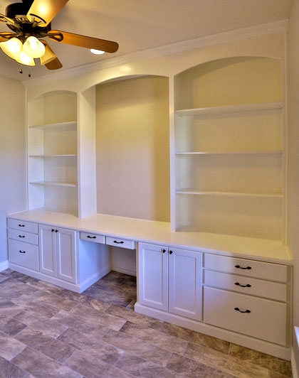 white built in bookshelves with desk