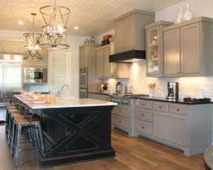 kitchen with black island and gray perimeter cabinets