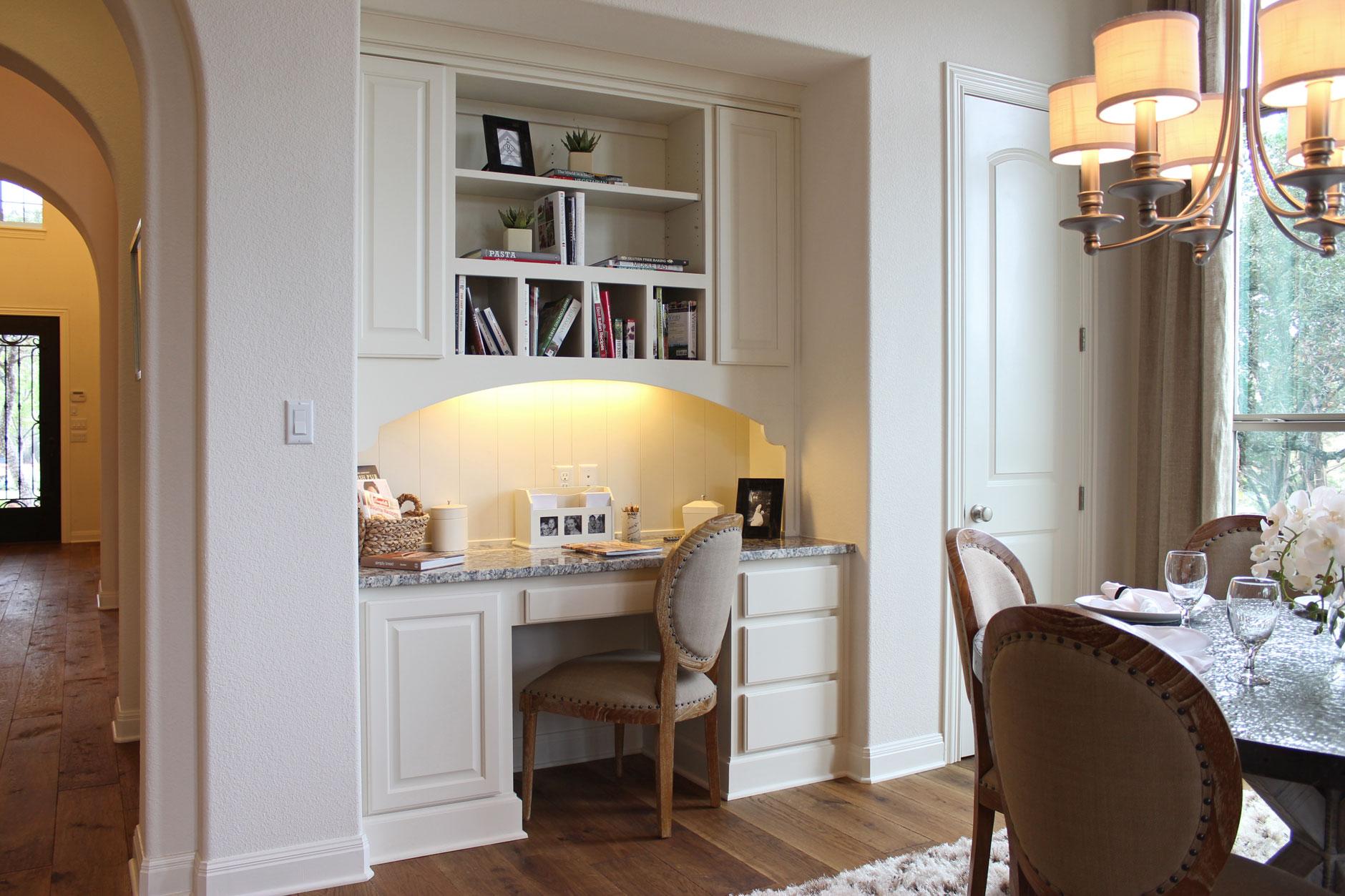 Breakfast room built-in desk with cubbies - raised panel doors by TaylorCraft Cabinet Door Company