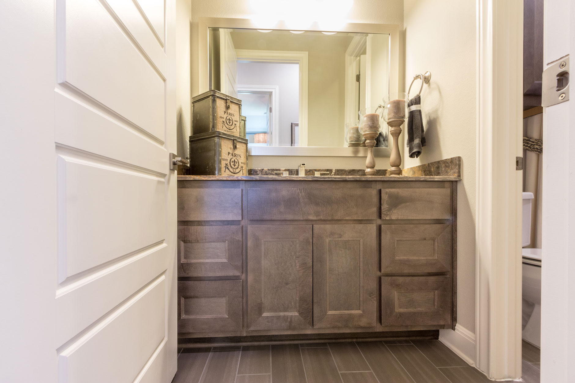 Bathroom cabinets with TaylorCraft mitered doors in hard maple with gray stain
