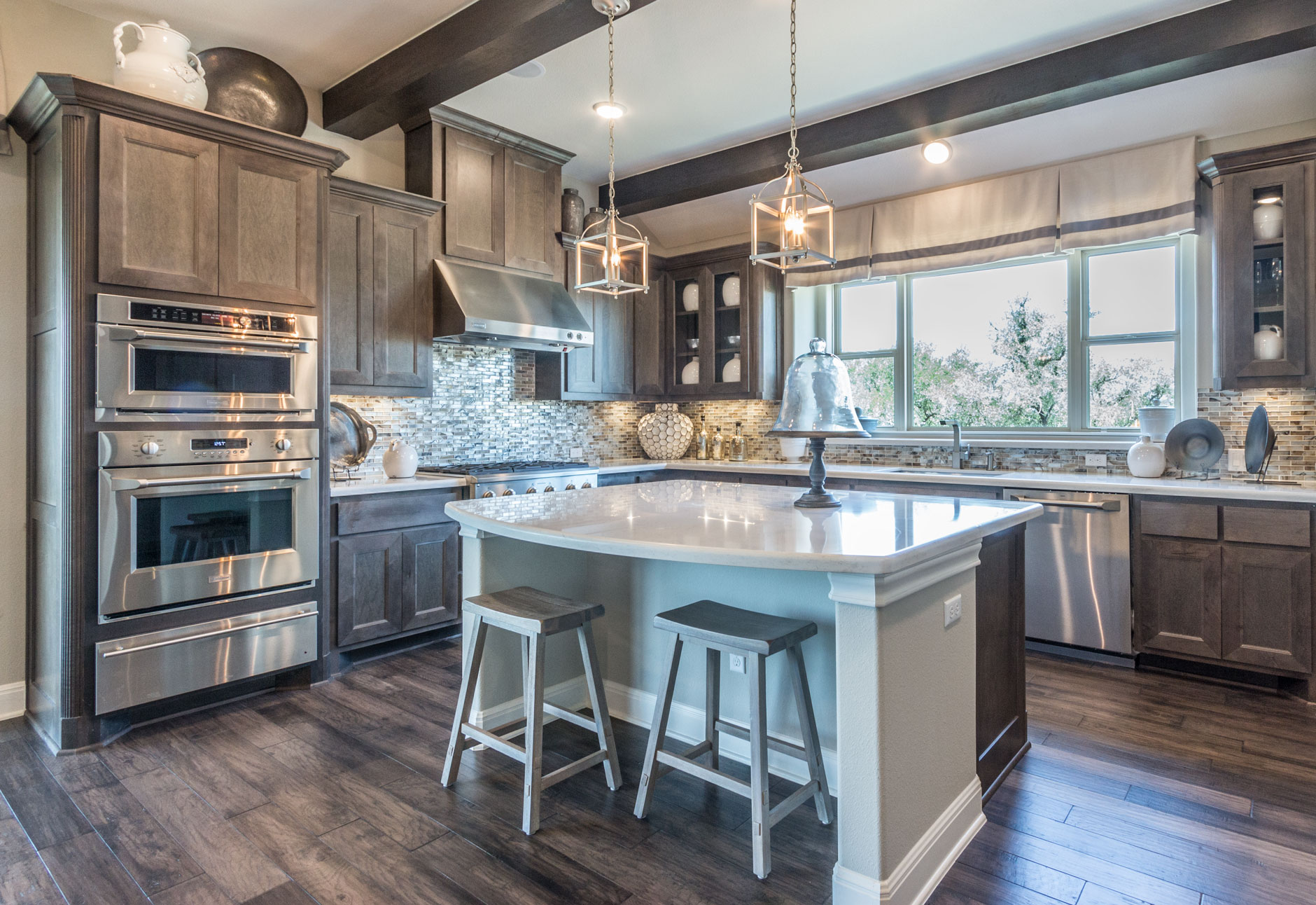 Kitchen with hard maple MW6 flat panel mitered cabinet doors stained driftwood gray