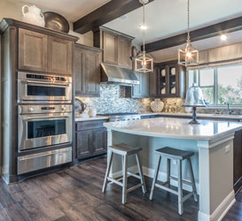 kitchen with maple cabinets and mitered cabinet doors in gray stain