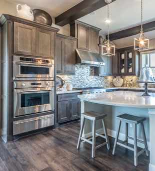 """Kitchen in mitered maple with MW6 frame and FP3/8"""" panel by TaylorCraft Cabinet Door Company with custom gray stain by customer"""