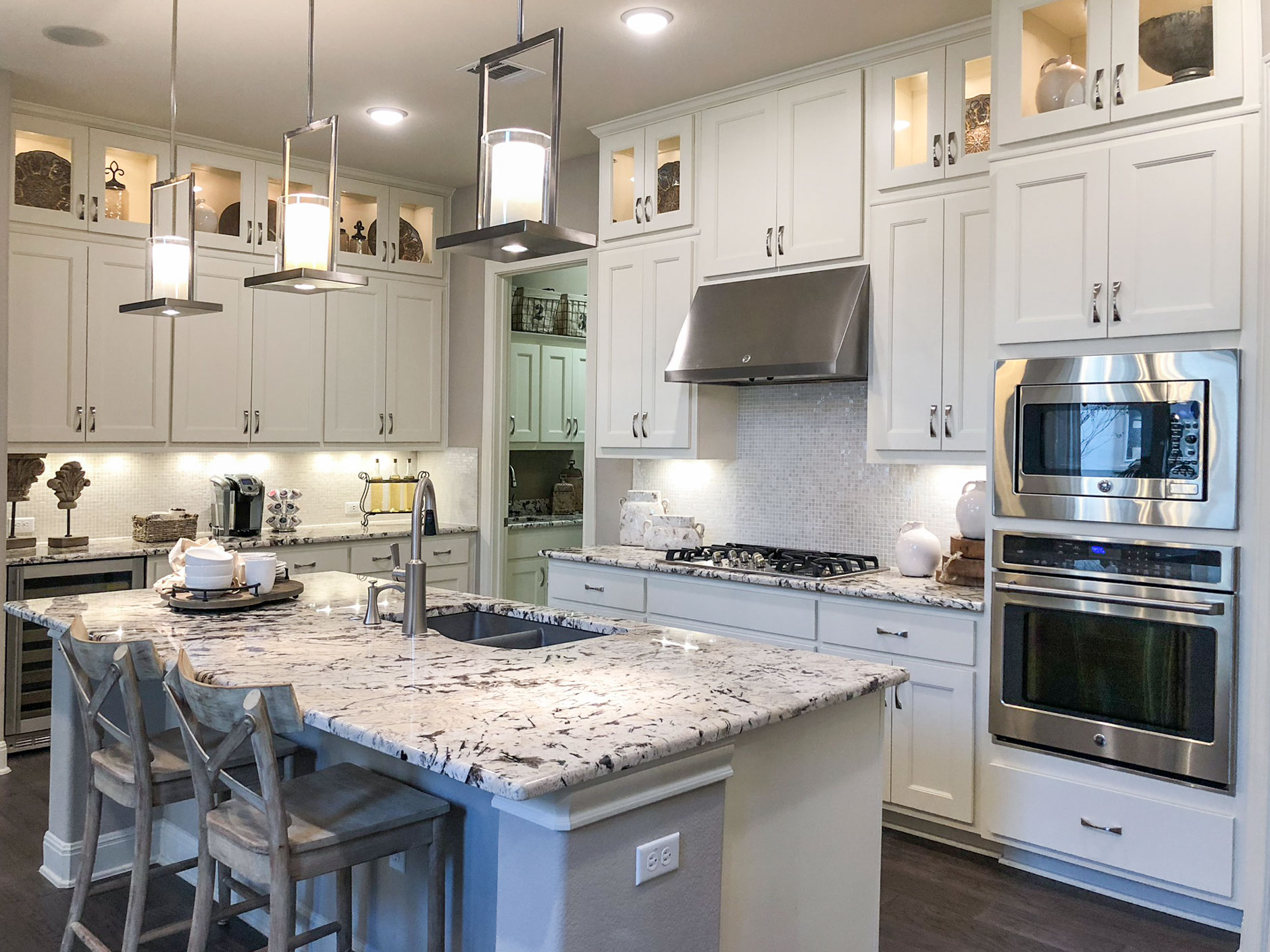 Nearly all-white kitchen with MW6, FP1/4 mitered cabinet doors by TaylorCraft