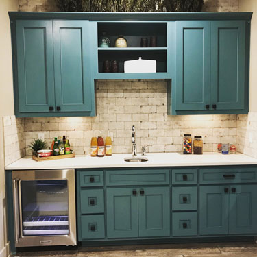 Paint grade shaker style cabinet doors in turquoise green-blue
