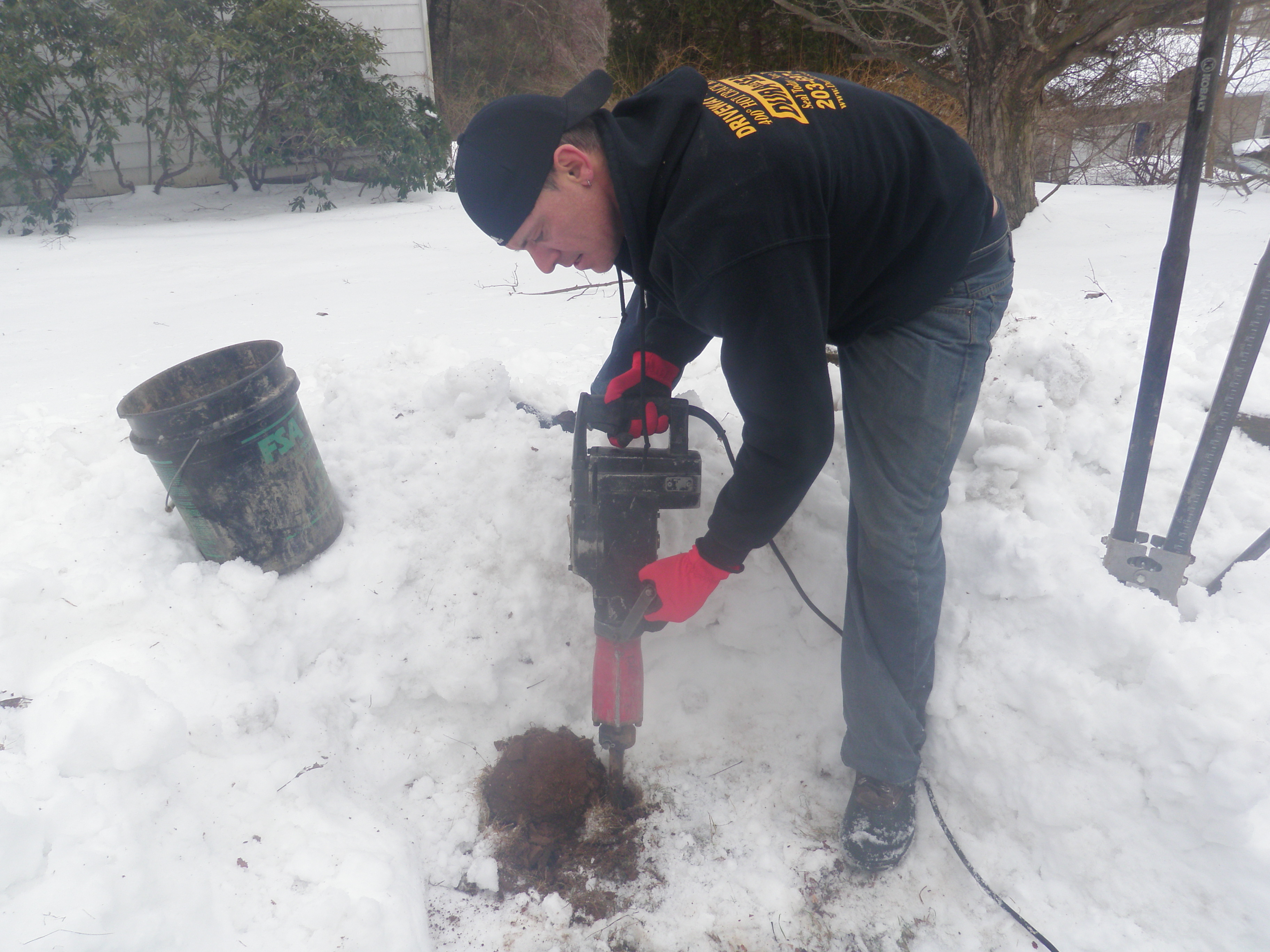 Digging New Hole for Mailbox Post with Hammer Tool