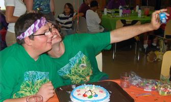 Give to ENF - brothers reunited taking selfie with birthday cake