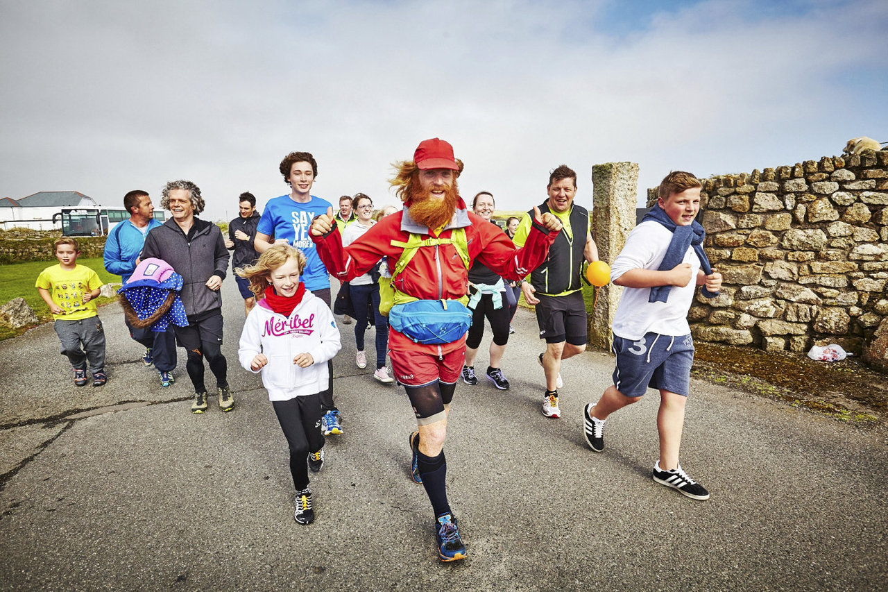 Sean Conway arriving at Land's End after completing The Ultimate British Triathlon. Land's End - 03.05.15. Photo from Red Bull