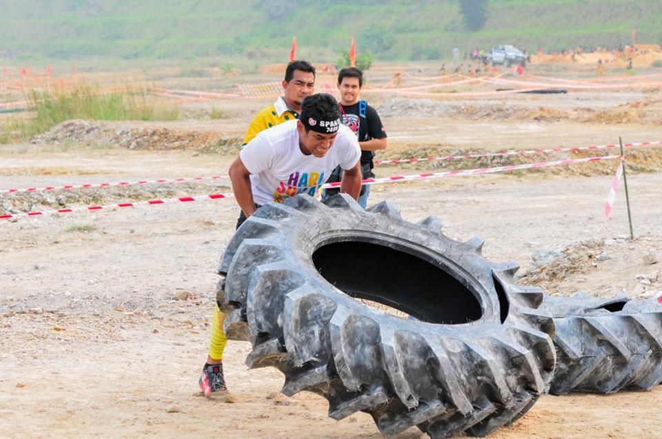 Youth and Sports Minister Khairy Jamaludin flipping tyres to get through the Spartan Race Malaysia. Photo from Spartan Race MY