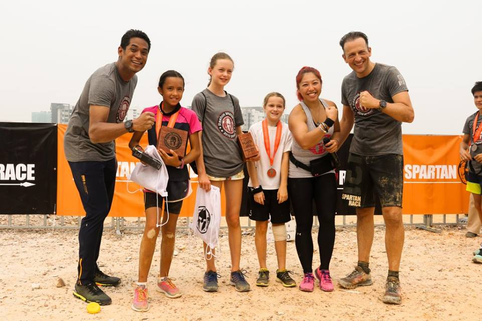 Khairy Jamaludin (left) posing with winners from the Spartan Kids races.   Photo from Spartan Race MY