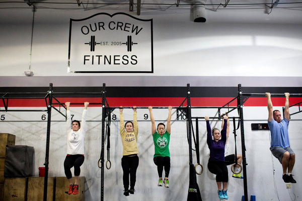 Some members compare the community aspect of CrossFit to that of church. Photo from New York Times