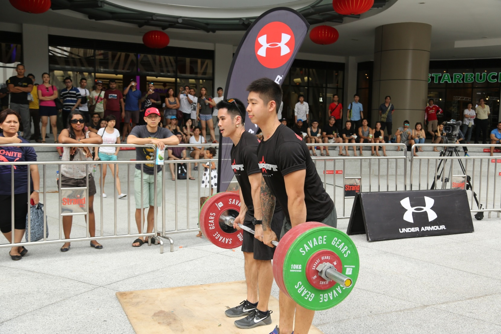Jonathan Wong, founder and co-owner of PushMore CrossFit Malaysia demonstrating the weightlifting before the team challenge kicked off.