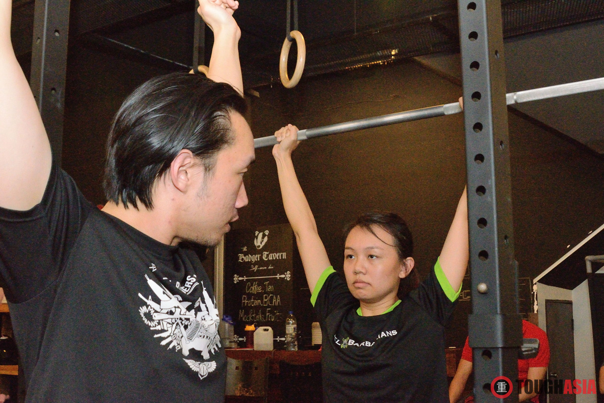 Coach Felix Tay demonstrating the Strict Press