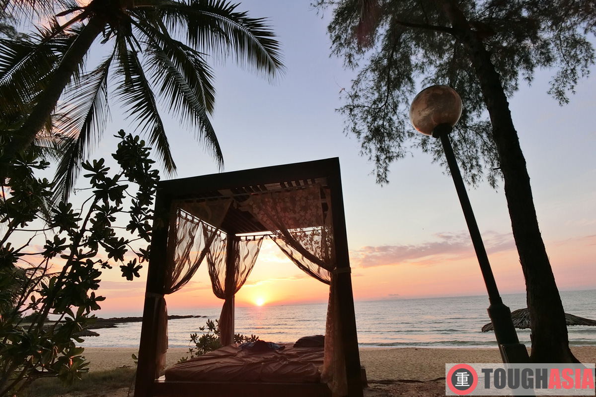 Watch the sunrise from the private pavilion dotting the sandy beach facing the South China Sea.