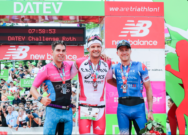 Jan Frodeno centered on the men's podium at Challenge Roth. (Team Challenge)