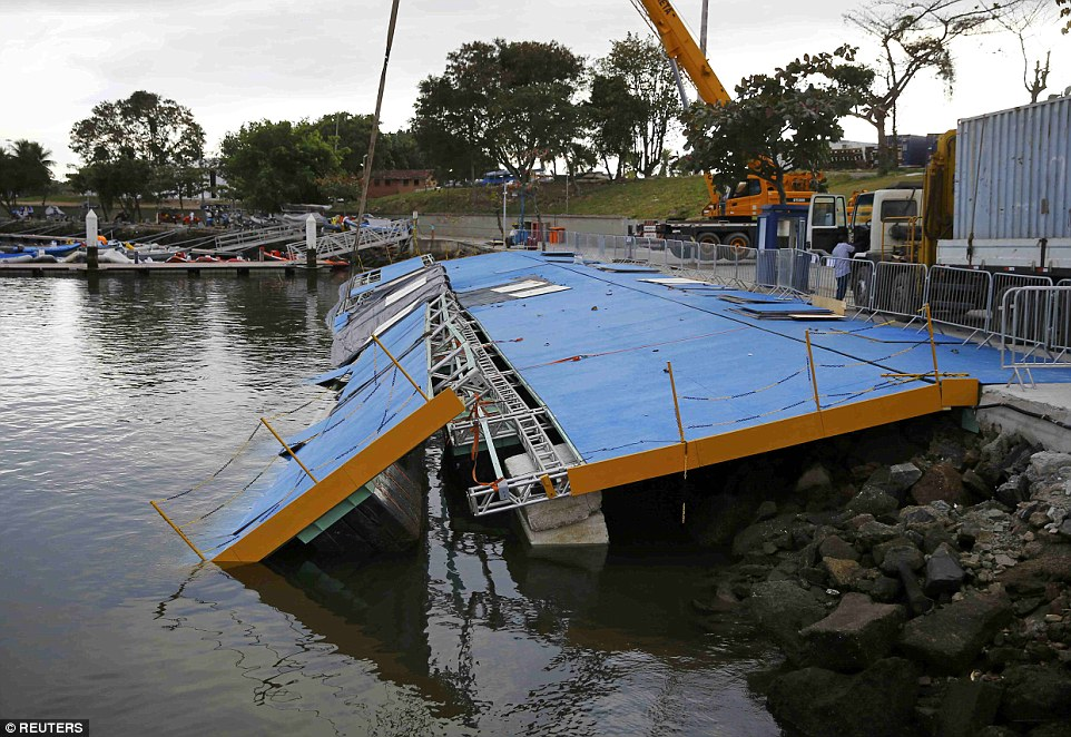 Ramp for sailors collapsed last week under high tide, and is hurriedly being repaired for the opening in a few days. (Reuters)