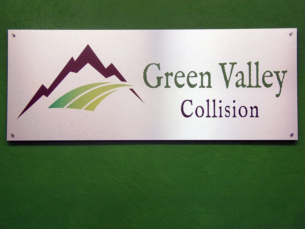 green-valley-collision-sign