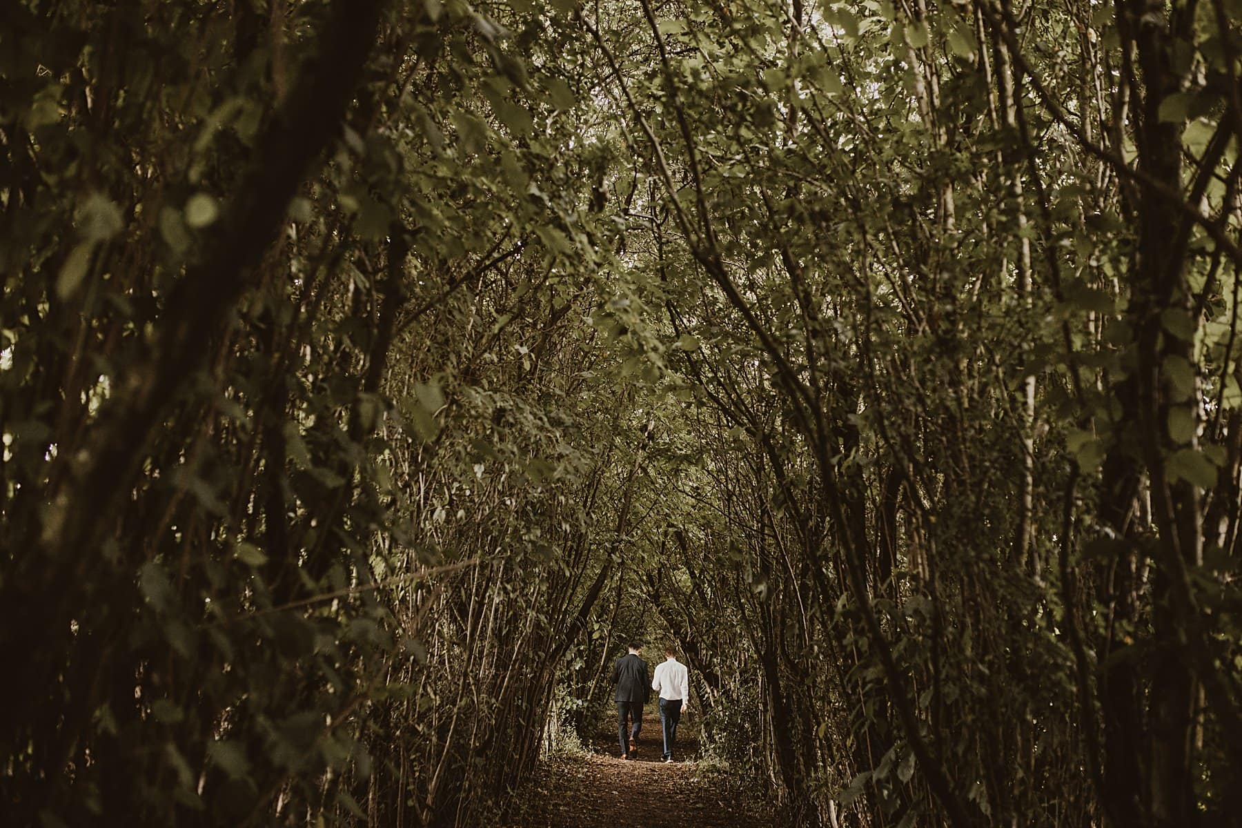 Nature corridor, men walking through