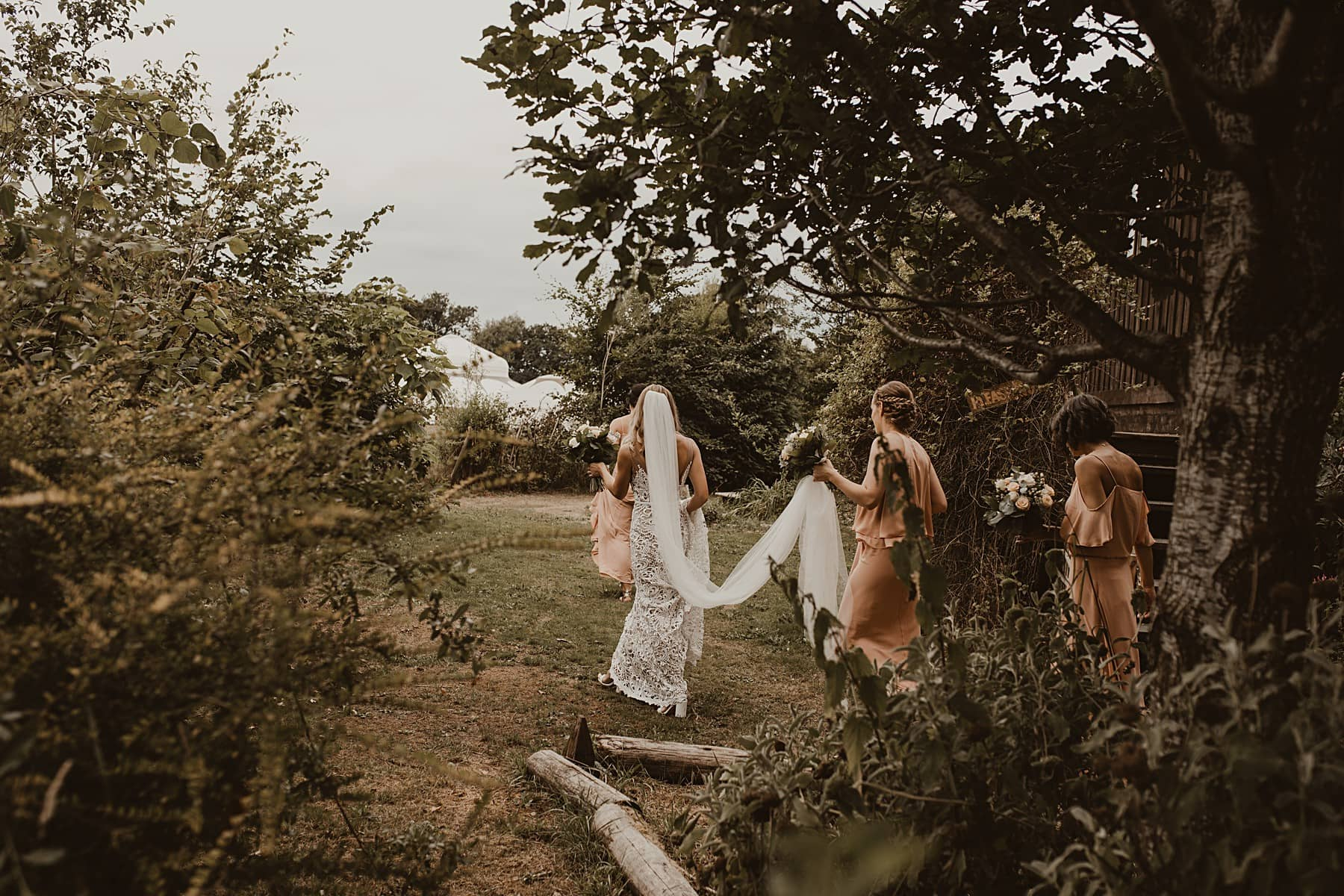 Bride and bridesmaids walking to ceremony