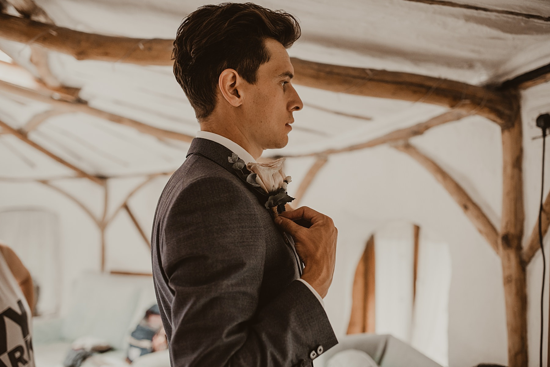 Groom putting on button hole