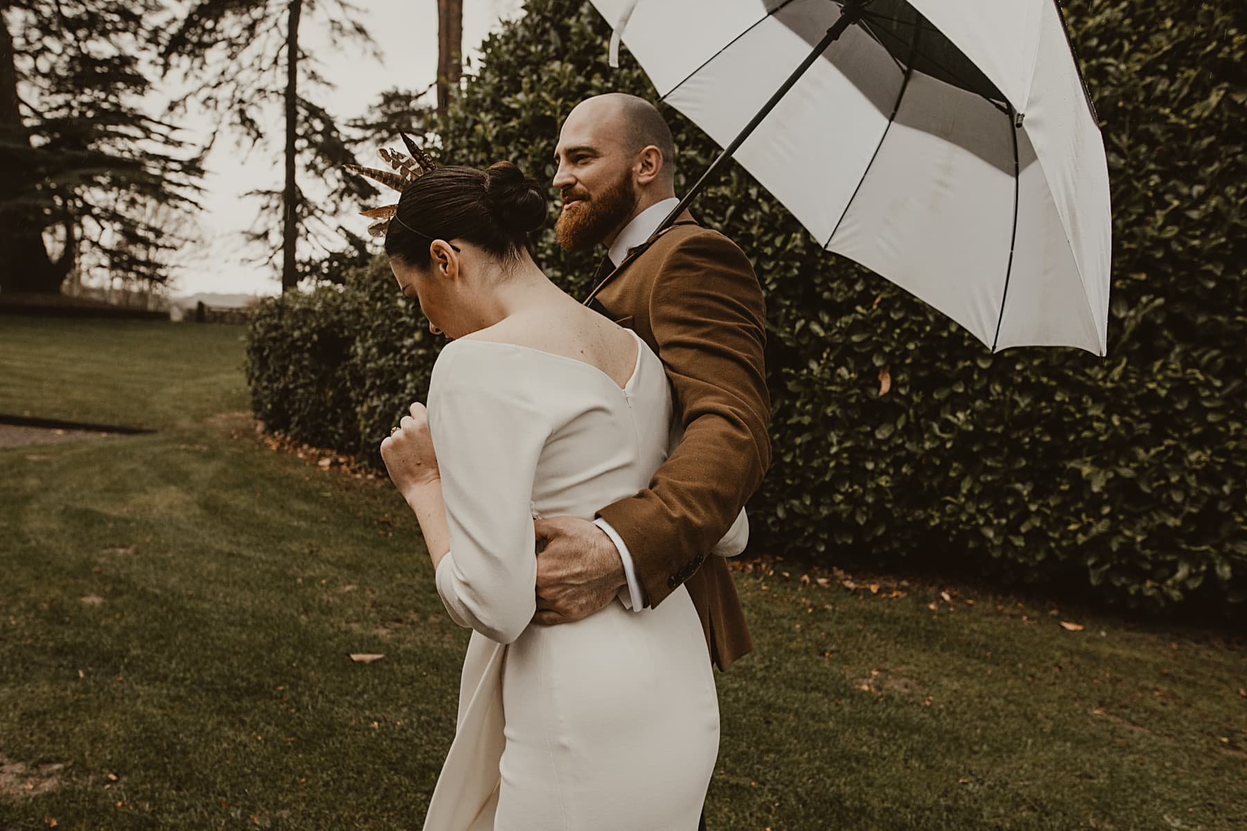 Couple walking with umbrella