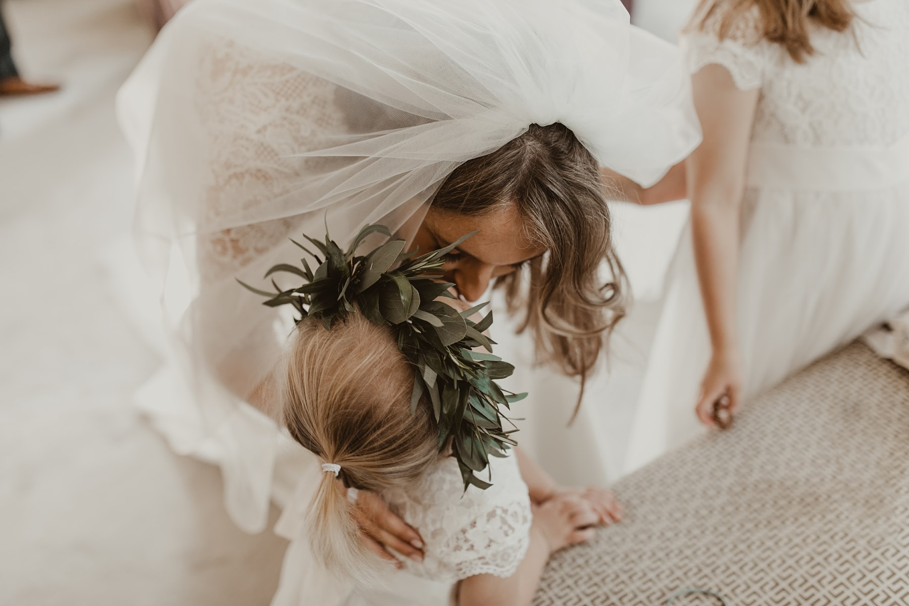 bride and flower girl cuddles