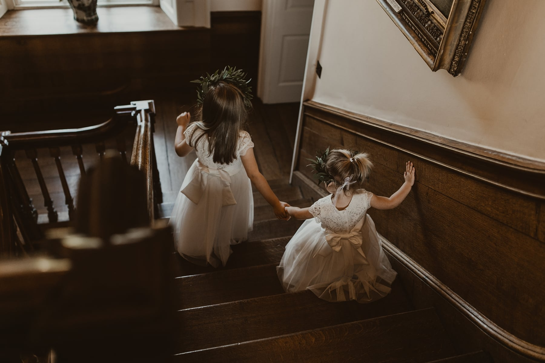 Flower girls walking down staircase at Iscoyd Park