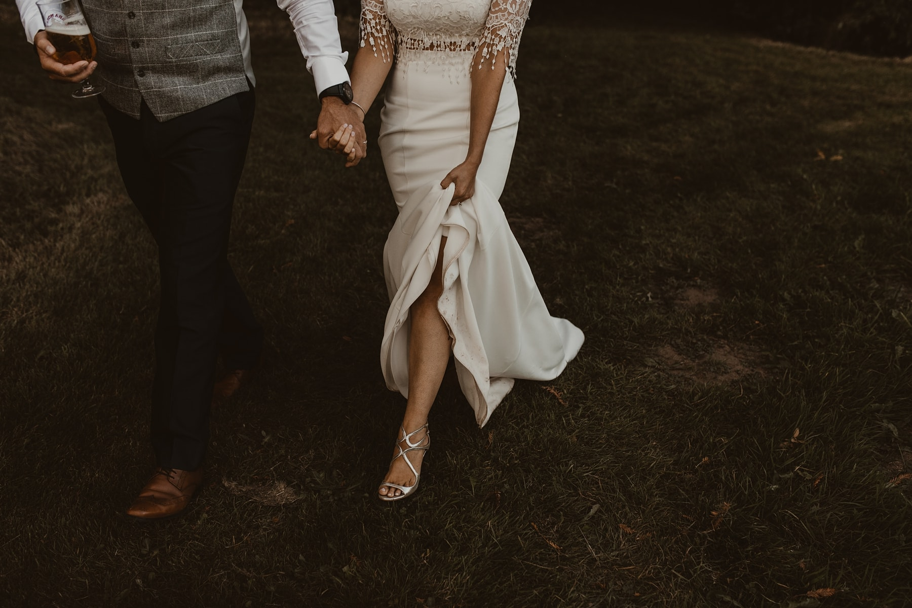 bride lifting dress and showing jimmy choo shoes