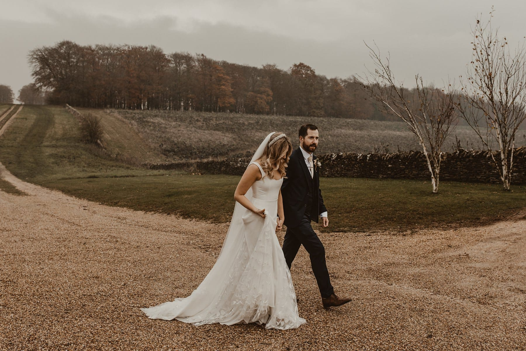 Couple walking through countryside at Stone Barn