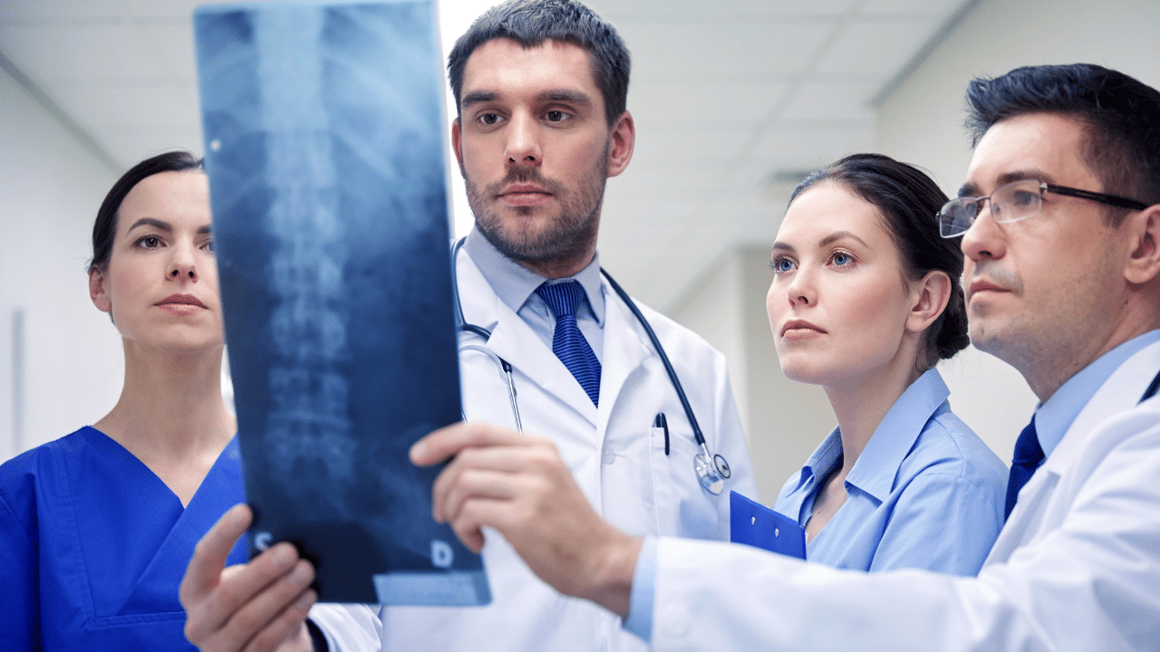 Surgeons Reviewing X-Ray